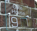Glass house signs